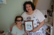 Cepranese speakers Antonietta and Gianna Patriarca, holding a photo of themselves taken in Italy before immigrating to Canada.