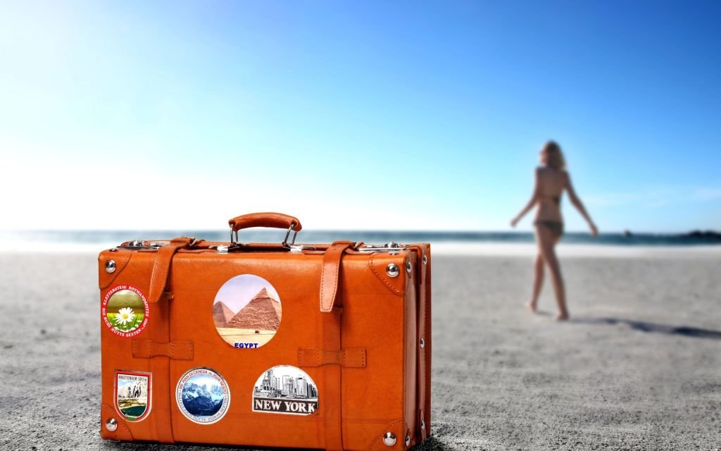orange-color-suitcase-travel-beach-sand-horizon-girl-resort-1024x640