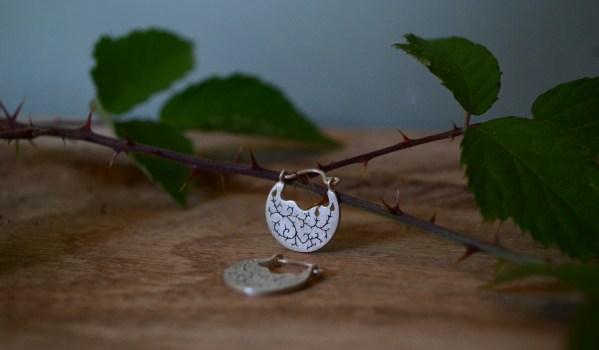 Bramble earrings on oak