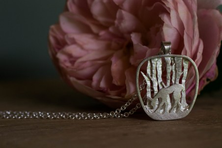 Silver deer pendant with pink rose and on oak
