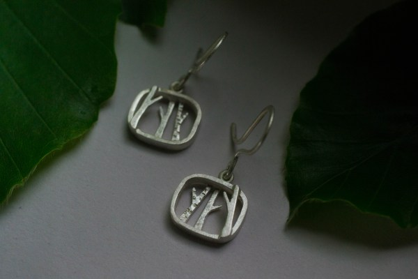 Tree earrings and leaves