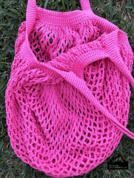 Bolsa de compra en punto red, rosa fucsia