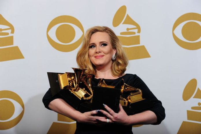 Adele posing with her six trophies at the 54th Grammy Awards in Los Angeles, California, February 12, 2012 (Photo: AFP)