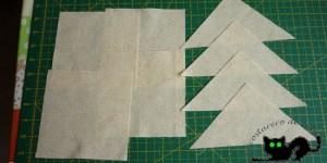 Cortamos los cuadrados y triángulos que usaremos como fondo de la estrella