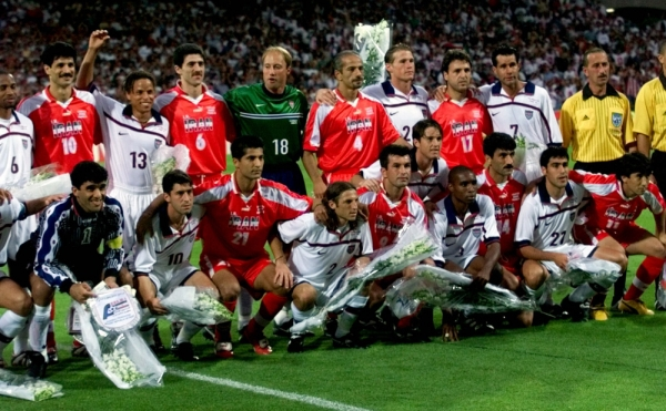 American and Iranian team players pose for a group picture before the start Sunday, June 21, 1998 of the Iran vs USA Group F World Cup match
