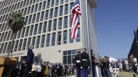 U.S. Secretary of State John Kerry watches the raising of the American flag at the newly opened U.S. Embassy in Havana, Cuba, Friday, Aug. 14, 2015. Kerry presided Friday over the flag raising ceremony in Havana as the United States and Cuba re-establish diplomatic relations after more than 54 years. (AP Photo/Ismael Francisco, Cubadebate)