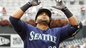 Seattle Mariners designated hitter Nelson Cruz celebrates his home run against the Minnesota Twins in the second inning of a baseball game Sunday, Sept. 25, 2016, in Minneapolis. (AP Photo/Bruce Kluckhohn)