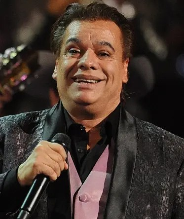 (FILE) Mexican singer Juan Gabriel performs during the Latin Grammy Awards show at the Mandalay Hotel in Las Vegas, Nevada, US, on November 5, 2009. Juan Gabriel announced on April 15, 2014 via his Twitter account, that due to health reasons he was postponing two weeks of shows of his US tour until further notice. According to one of the singers' spokespersons, he was hospitalized with pneumonia.   AFP PHOTO/Mark RALSTON