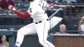 Texas Rangers' Nomar Mazara follows through on a single to left during the first inning of a baseball game against the New York Yankees on Tuesday, April 26, 2016, in Arlington, Texas. (AP Photo/Tony Gutierrez)