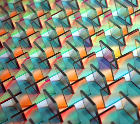 netloid_colorful-prism-like-mazes-and-mandalas-of-light-installed-vertically-on-walls-by-chris-wood7