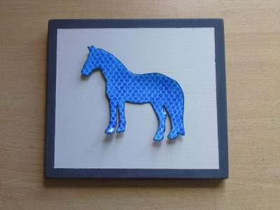 spotty blue horse enamelled wall hanging