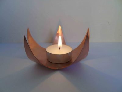 side view of star tealight holder with tealight