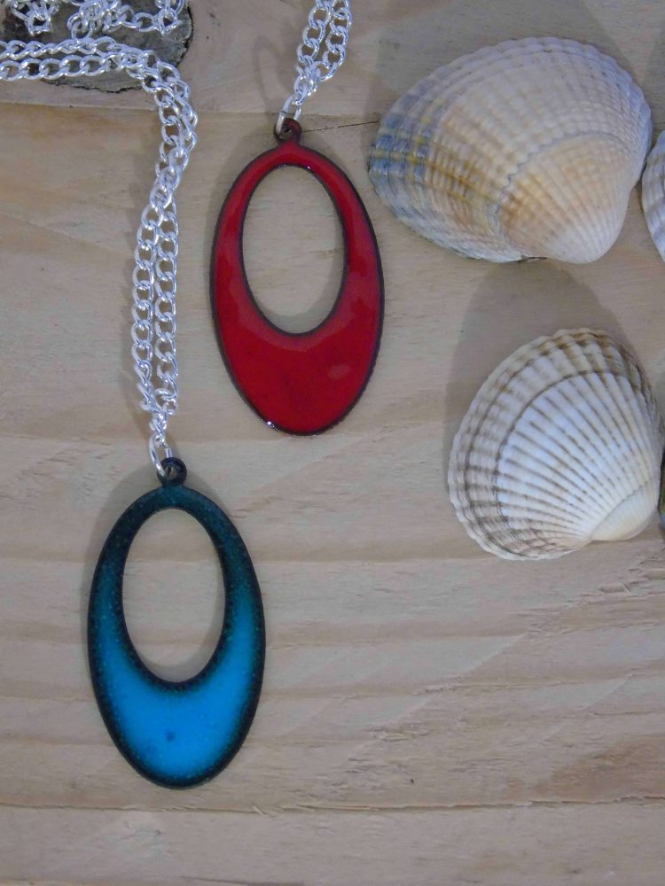 two enamelled necklace pendants