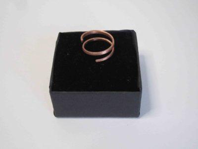 Small spiral copper ring on presentation box