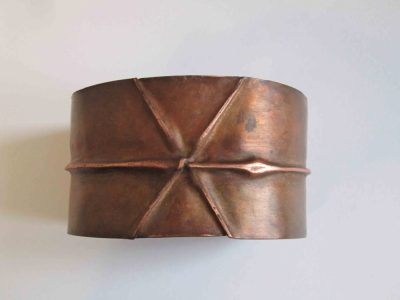 Fold formed cuff bracelet with cross design from above