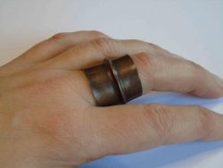 tall dark cuff ring being worn