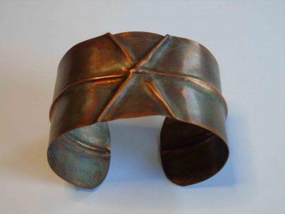Fold formed bracelet with cross pattern