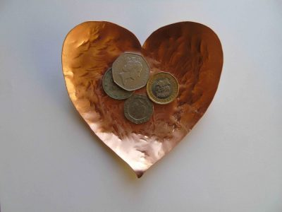 Heart shaped bowl with coins