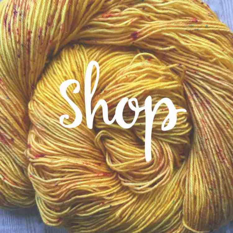 """Yellow yarn with """"Shop"""" written over it, linking to the Eleanor Shadow shop page"""