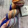 Hand holding a multicolour chain-plied hand spun yarn