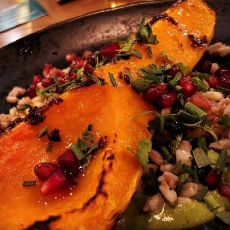 Chargrilled Crown Prince squash grown for us by Riverford Organic, served with kale & cashew nut mole