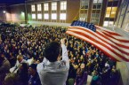 DENVER, CO - FEBRUARY 1: Peter Wright holds an American flag above hundreds of people who were forced to organize in a parking lot during the caucus at East High school in Denver, Colorado on March 1, 2016. 18 precincts were represented at East High School and thousands of people turned out for the caucus. Organizers had anticipated about 20% of people from their precincts would turn out and many more  actually came. (Photo by Helen H. Richardson/The Denver Post)