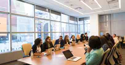 Group of people meeting around a conference table