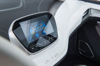 "2015 Chevrolet Bolt EV Concept Interior features unique crossover proportions. A flat, flow-through floor adds to the roominess of the cabin. Slim-architecture seats mounted on exposed aluminum pedestals create a floating effect. The minimalist center console ""floats"" – suspended from the front seats. Leather wrapped electronic shifter with anodized orange accents adds to the hi-tech feel of interior."