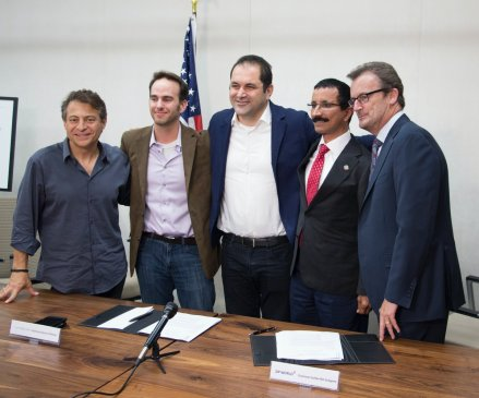 Signing the agreement from Hyperloop One are board member Peter Diamandis, President of Engineering Josh Giegel, Executive Chairman Shervin Pishevar, and Hyperloop One CEO Rob Lloyd. Second from right is DP World Chairman and CEO Sultan Ahmed Bin Sulayem.