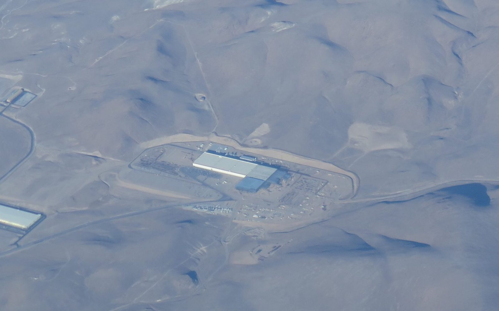 New aerial picture of the Tesla Gigafactory shows new sections going up