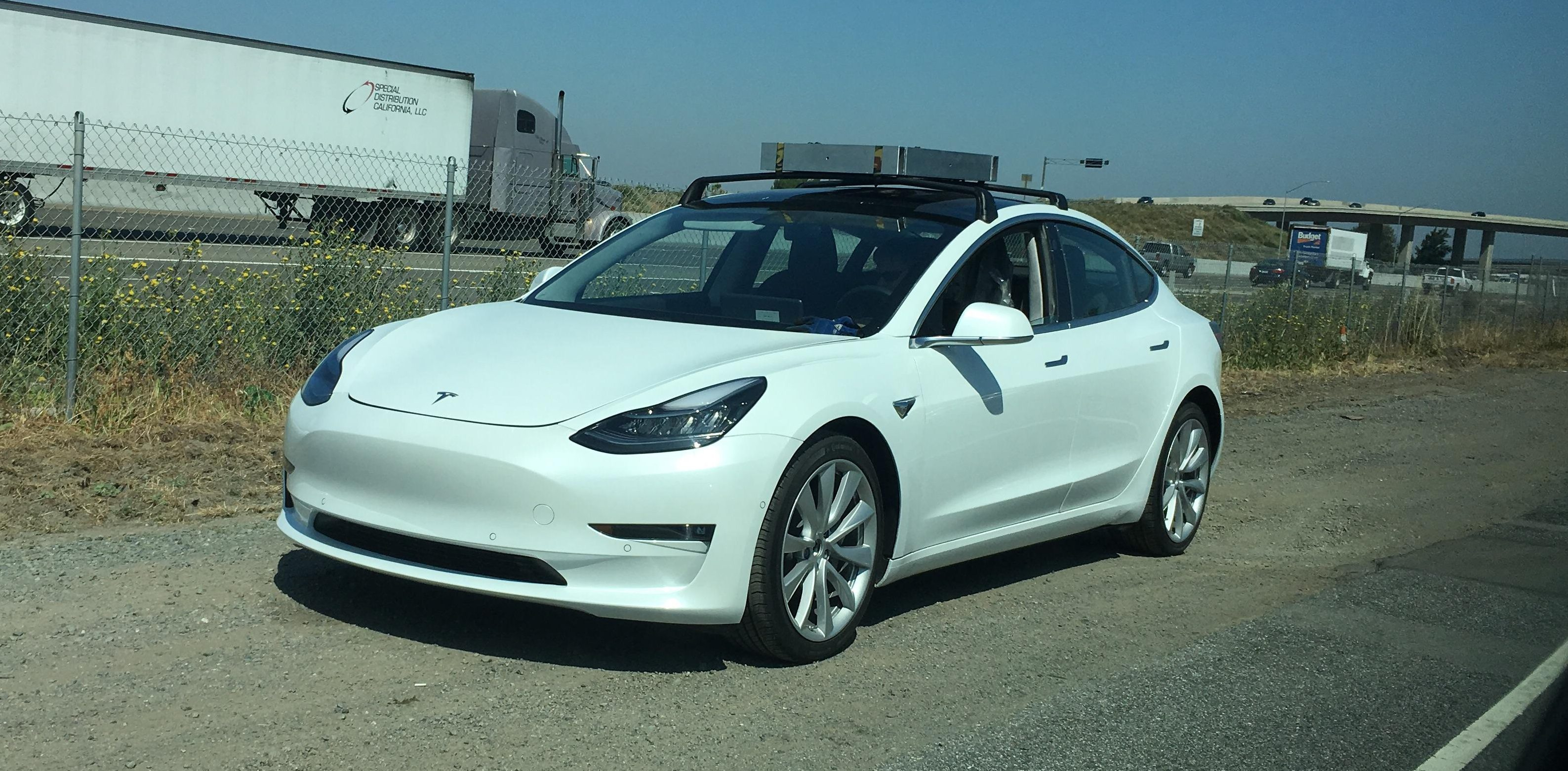 tesla model 3 spotted testing with roof