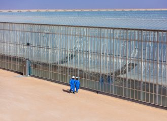 Worker walking at facility in Oman.