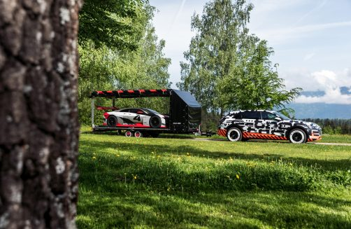 Audi e-tron prototype tows trailer with Audi e-tron Vision Gran Turismo concept car