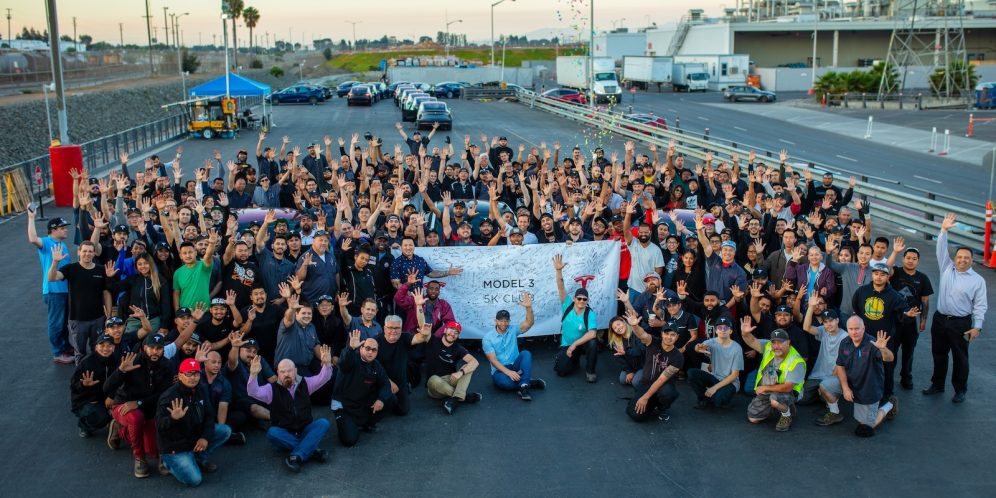 Tesla-employees-celebrate-Model-3