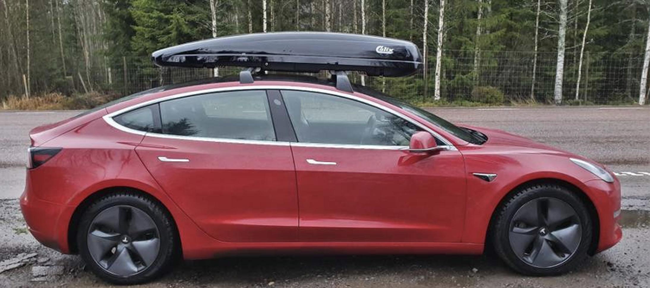 tesla model 3 with roof rack box gets