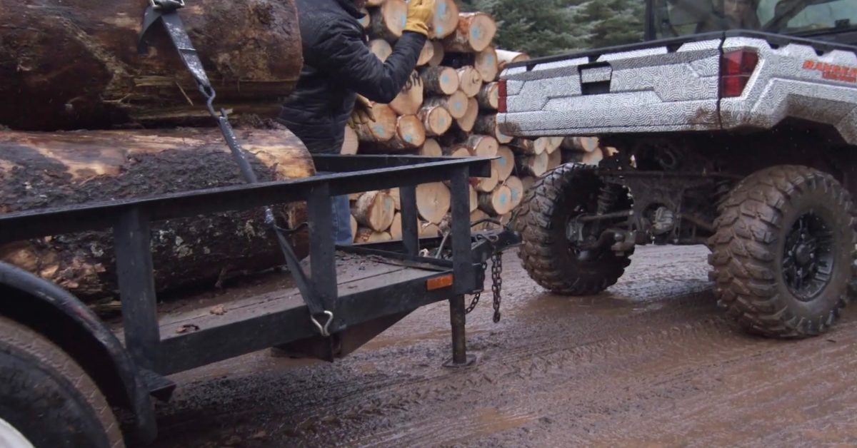 Watch new electric Polaris Ranger UTV tow a fully loaded logging truck ahead of launch thumbnail