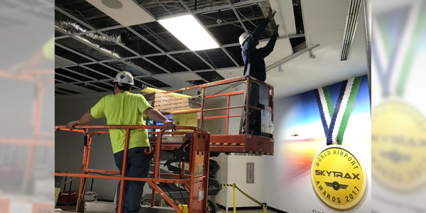 Workers at the Cincinnati/Northern Kentucky International Airport (CVG) install LSI Industries' SFP Series ultra-thin edge-lit LED flat panels