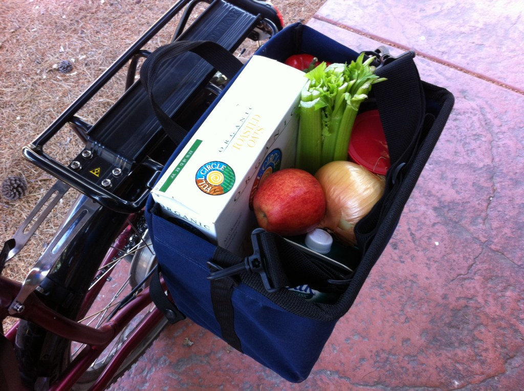 It would be nice to see the Jandd Grocery Pannier come stock with a cover to contain the contents when riding. You can buy an optional cover.