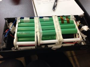 A lithium ion electric bike battery pack with its cells exposed.