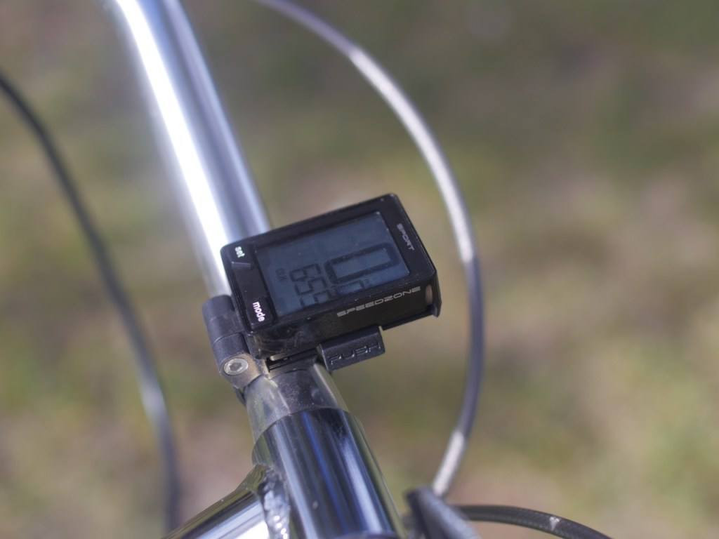 """The kit comes with this wireless Specialized cyclometer. The best way to monitor battery levels with the 250 watt kit is to keep track of distance traveled. It's the electric bike equivalent of """"dead reckoning""""."""