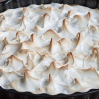 Lemon and lime meringue pie
