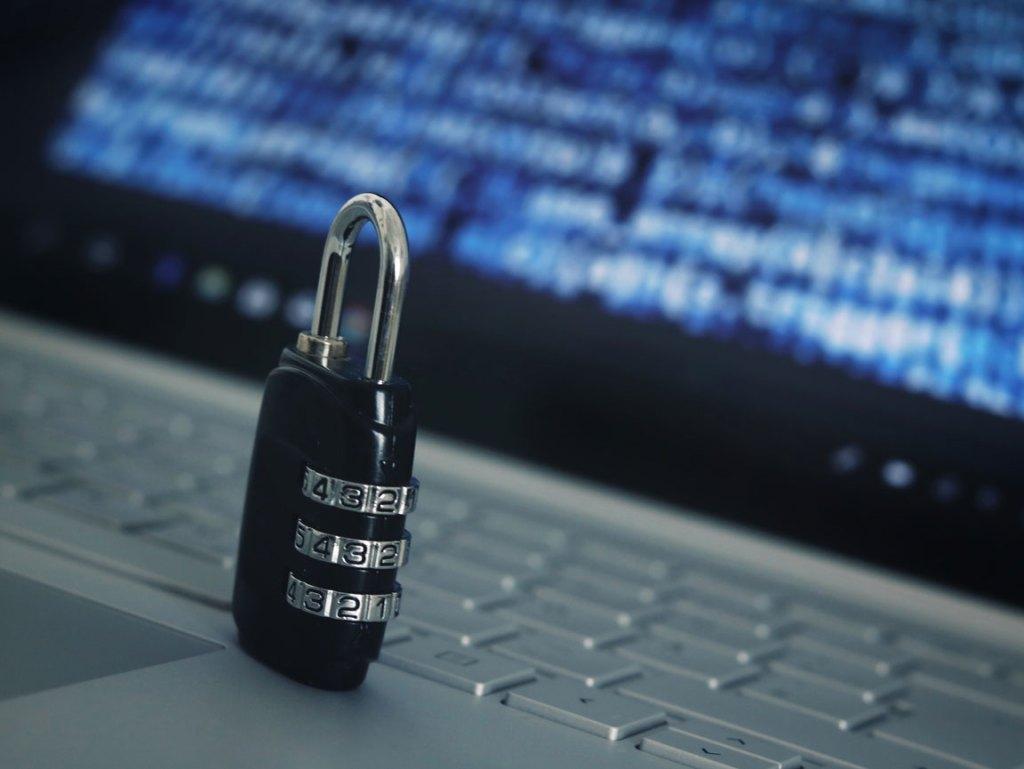 lock on laptop representing cybersecurity