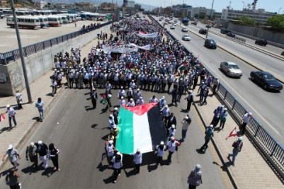 Demonstrators calling for Palestinian human rights in Lebanon march from south Beirut to downtown. (Matthew Cassel)