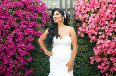 Bride in front of bright pink foliage at Arden Hills