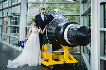 Wedding couple standing with the tip of a rocket
