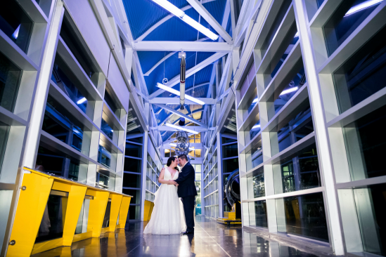 Bride and groom at Space & Rocket Center in Oakland, CA