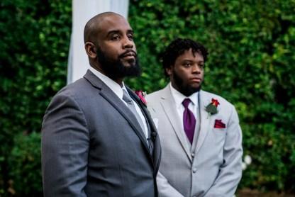 Groom & groomsman waiting at alter