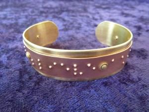 Cuff bracelet close-up (Conceive, Believe, Achieve)