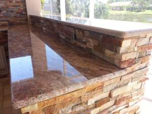 Close-up of Rosewood Granite and Golden White Stacked Stone