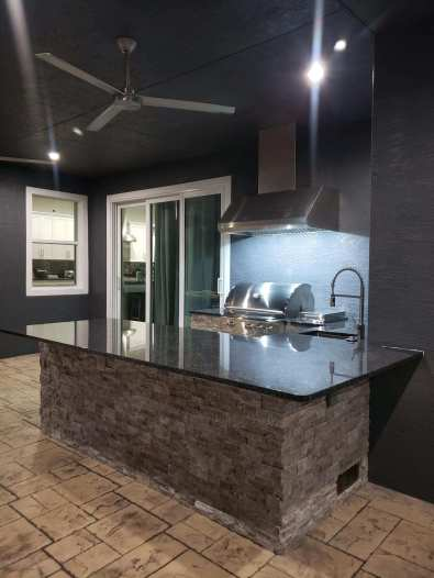 U-Shaped outdoor kitchen with High Arc sink